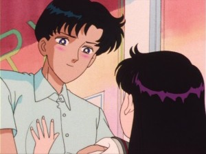 Mamoru blushes while looking at Rei