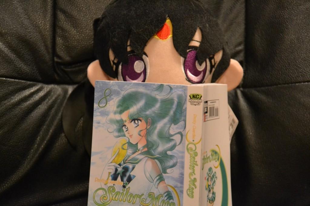 Sailor Mars reading Sailor Moon manga vol. 8 - Sailor Neptune cover