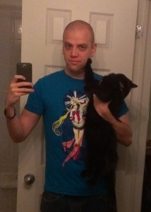 "Adam wearing ""By Moonlight"" shirt with Luna the cat"