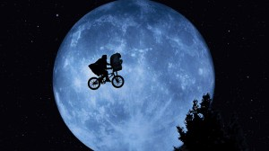 Elliott and E. T. in front of the Moon