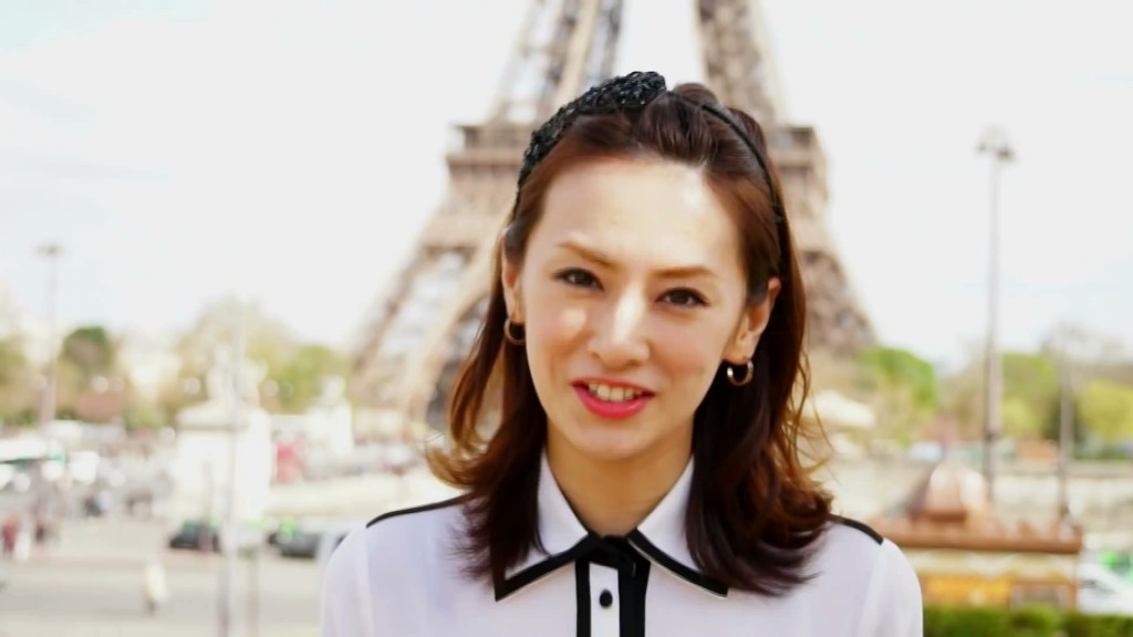 Keiko Kitagawa in France in front of the Eiffel Tower
