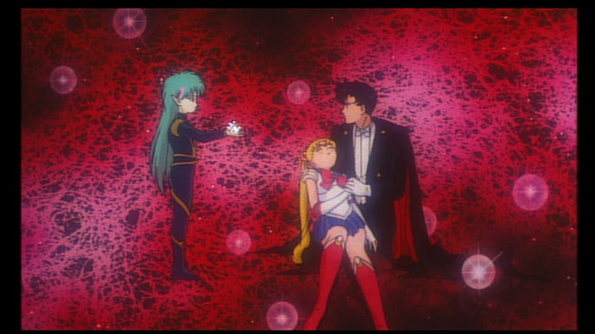 Fiore offers the Kissenian to Tuxedo Mask and a dead Sailor Moon - Sailor Moon R Movie