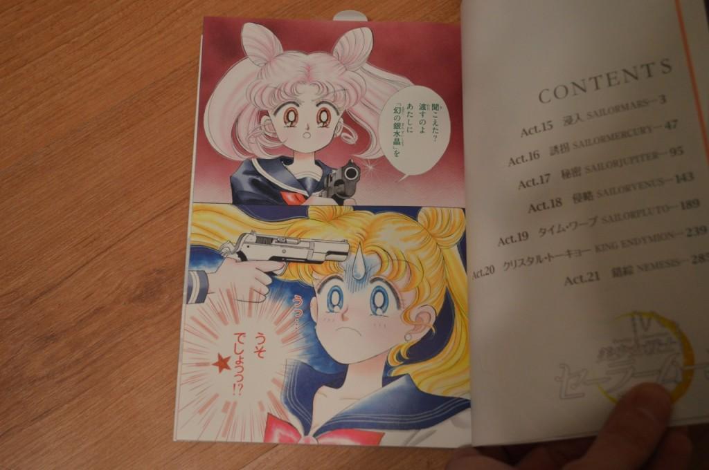 Chibiusa aiming a gun at Usagi's head - Volume 3 of the Complete Edition of the Sailor Moon Manga
