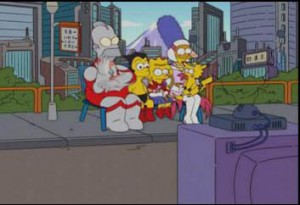 The Simpsons - Homer dressed as Ultraman, Bart as Astroboy, Lisa as Sailor Moon, Marge as Jun from Gatchaman and Maggie as Pikachu from Pokemon