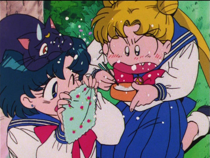 Sailor Moon R episode 55 - Ami and Luna shield themselves as Usagi eats