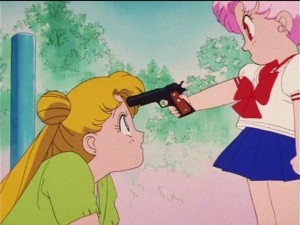 Sailor  Moon R episode 60 - Chibiusa pointing a gun at Usagi