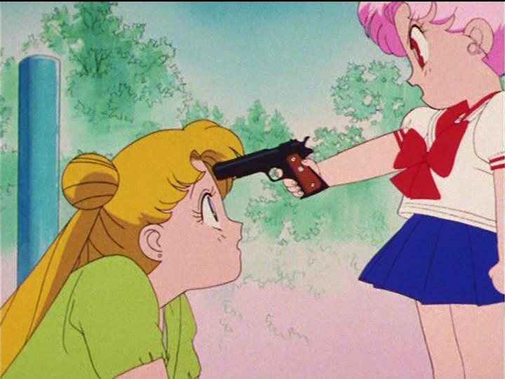 Sailor Moon R episode 60 - Chibiusa pointing a gun at Usagi