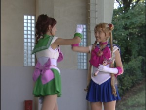 Live Action Pretty Guardian Sailor Moon Act 7 - Sailor Jupiter and Sailor Moon in front of windows