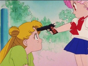 Sailor Moon R episode 60 - Japanese DVD - Chibiusa points a gun at Usagi