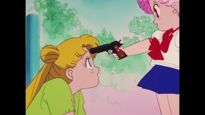 Sailor Moon R episode 60 - Japanese Blu-Ray - Chibiusa points a gun at Usagi