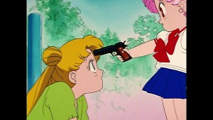Sailor Moon R episode 60 - Viz Blu-Ray - Chibiusa points a gun at Usagi