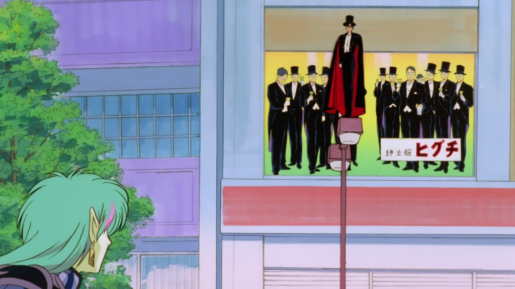 Sailor Moon R The Movie - Tuxedo Mask in front of a billboard