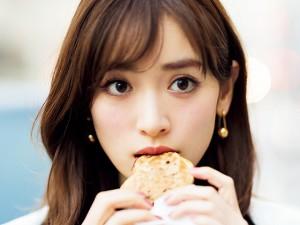 Rika Izumi eats a cookie